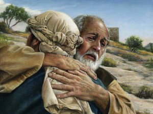 Prodigal son in father's arms.